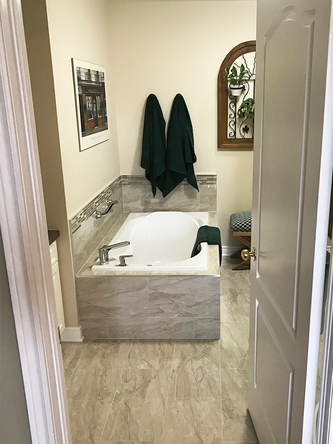 Second level bathroom renovation with bath tub