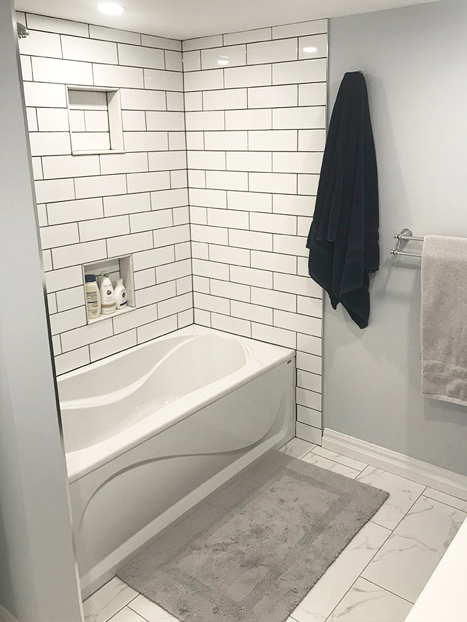 spare bathroom renovation with shower bathtub